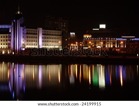 night city is reflected in water