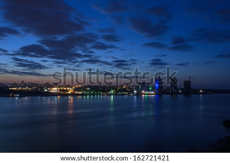Night city landscape with a river view - stock photo