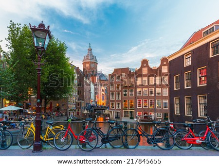 Night city view of Amsterdam canal, bridge and typical houses, Holland, Netherlands. Long exposure. - stock photo