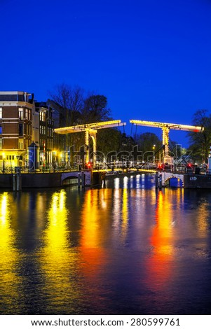 Night city view of Amsterdam, the Netherlands with Amstel river - stock photo