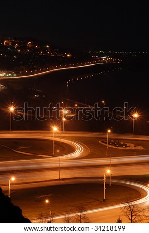 night city with road junction - stock photo