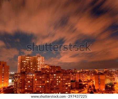 Night cityscape. 20 minutes after sunset long exposure shot. Typical modern illuminated residential area. Kiev. Ukraine. - stock photo