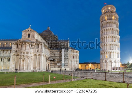 night cityscape of famous piazza dei miracoli in pisa with dome and leaning tower close up detail view