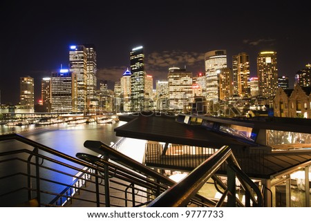 Night cityscape with buildings and harbor in Sydney, Australia. - stock photo
