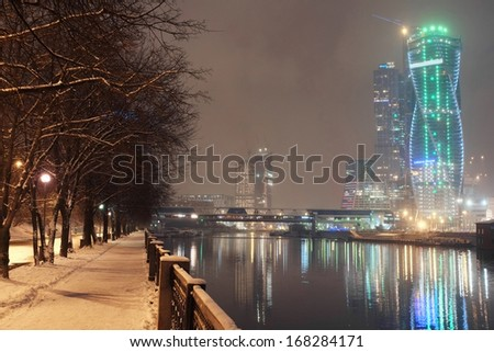 Night cityscape with the image of Moscow City - stock photo