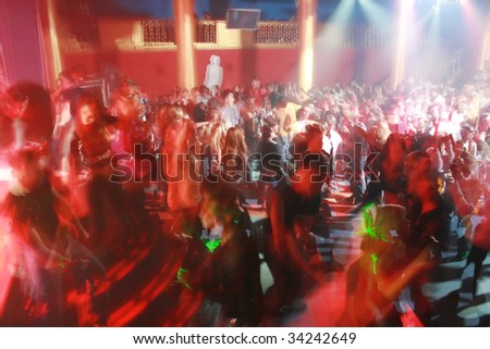Night club picture made with long exposure, no recognizable faces - stock photo