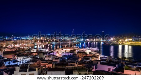 Night colorful view of Ibiza old town and harbour - stock photo