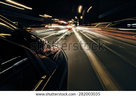 Night driving abstract - fast car - stock photo