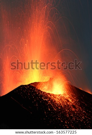 Night eruption volcano Stromboli  Glowing rocks falling down in Phase2
