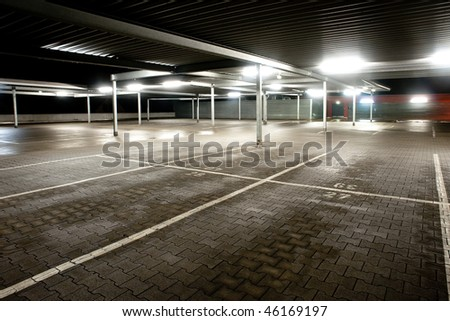Night exposure of an empty parking level of a supermarket - stock photo