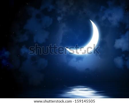 Night fairy tale - bright moon reflected in water - stock photo