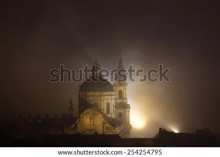 Night fog covering Saint Nicholas Church in Mala Strana in Prague, Czech Republic. - stock photo