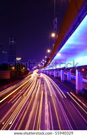 night highway connection with light traces from moving cars - stock photo