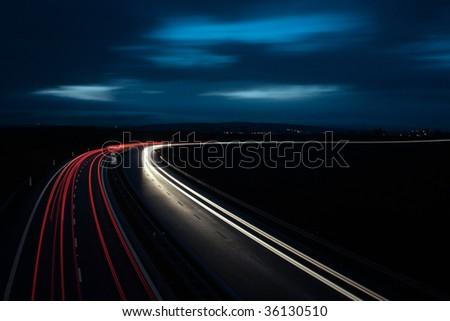 Night highway in the UK - stock photo