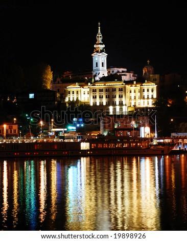 night illuminated Belgrade from river with light reflection - stock photo
