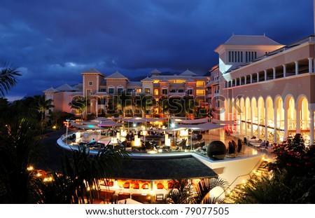 Night illumination of luxury hotel and clouds, Tenerife island, Spain - stock photo