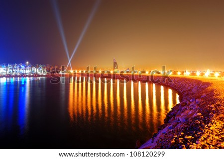 Night illumination of the luxury hotel on Palm Jumeirah man-made island, Dubai, UAE - stock photo