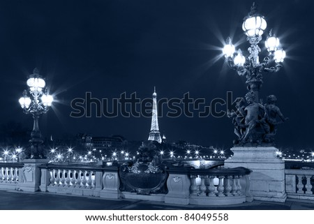 Night illumination on the bridge of Alexander III and Eiffel Tower in the background. Paris. France. - stock photo