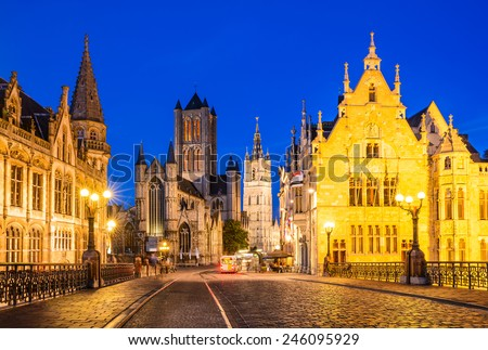 Night image of Saint Nicholas Church and Belfry tower, one of famous landmarks of Ghent, Gent in Flanders, Belgium. - stock photo