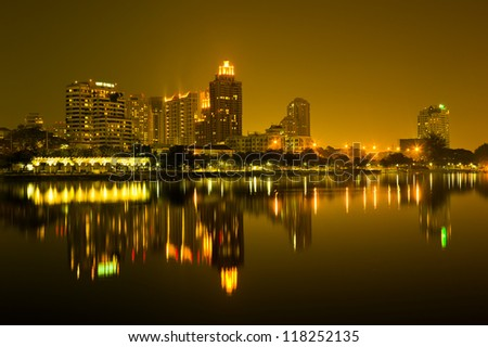 Night in Bangkok with building reflect on water