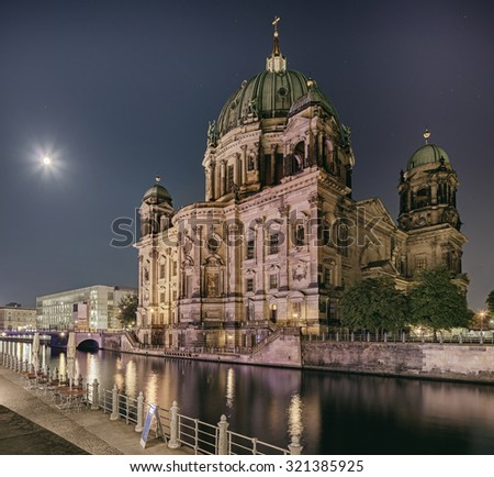 Night in Berlin. Moon shining over the Dome cathedral - stock photo
