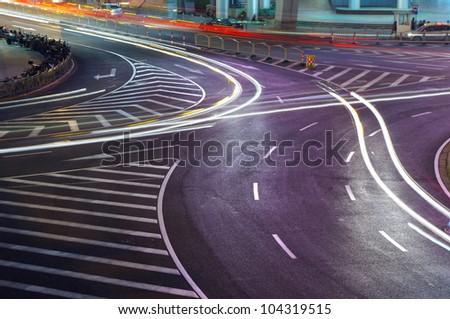 Night in Shanghai traffic light trails - stock photo