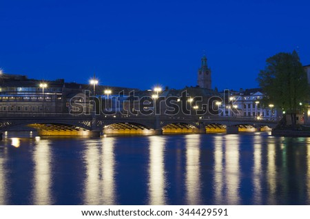 Night in Stockholm city with water reflection and town hall