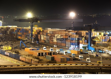 night industrial port.  containers and trucks - stock photo