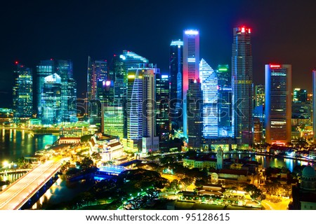 Night landscape of Singapore's downtown high-rise buildings and neighborhoods in colored night light - stock photo