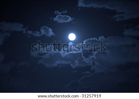 Night landscape of the cloudy sky and the moon - stock photo