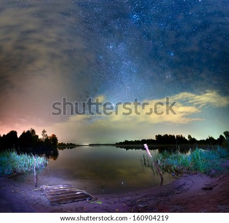 Night landscape with bright starts lake in russia. - stock photo