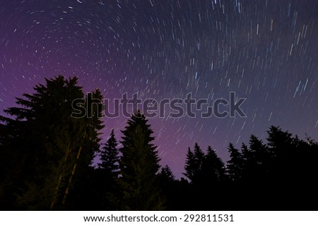 Night landscape with star trail - stock photo