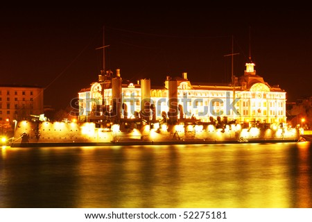 Night landscape with the ship and shoreline (Aurora, a historic monument of Saint-Petersburg, Russia)