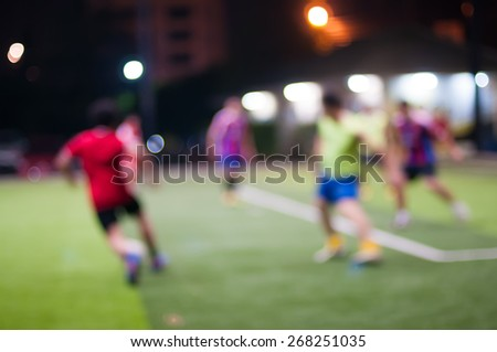 night life.motion blur.players playing football(soccer) - stock photo