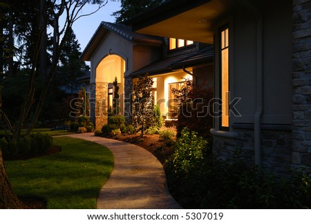 Night Light in Front of a large house