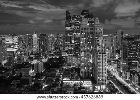 Night light of Bangkok. Panoramic and perspective view light blue background of glass high rise building skyscraper commercial of future. Business concept of success industry tech (black white)