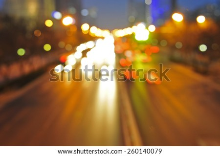 Night light trails in modern street financial center in Beijing, China  - stock photo
