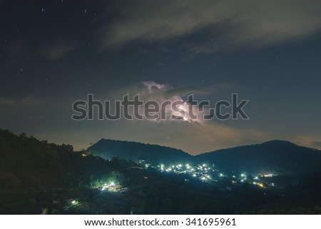 Night lightning strike over mountains resort with star on Mon Jam, Chiang Mai, Thailand - stock photo
