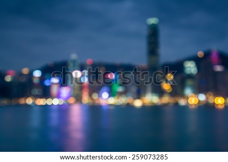 Night lights bokeh of Hongkong city with water reflexion - stock photo