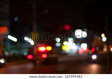 Night lights. Motion blur.lights at night on road with car - stock photo