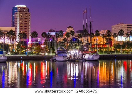 Night lights of Long Beach's skyline reflect in the water at the marina, California - stock photo