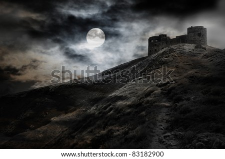 Night, moon and dark fortress black and white halloween theme - stock photo