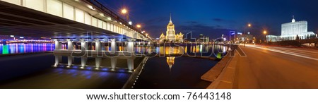 Night Moscow.View  of the hotel Ukraine, the New Arbat bridge and the House of Government of Russian Federation (the Russian White House) from  Krasnopresnenskaya quay. Panorama. - stock photo