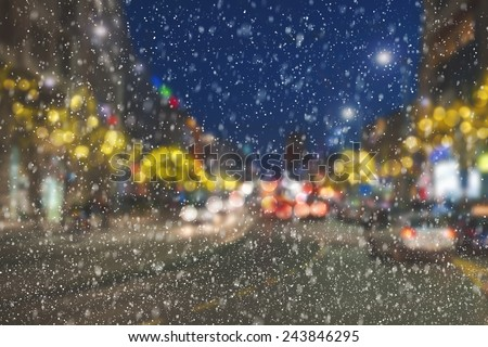 Night on streets in the city center with  New Year lighting arrangement and snow falling. Belgrade - Serbia - stock photo
