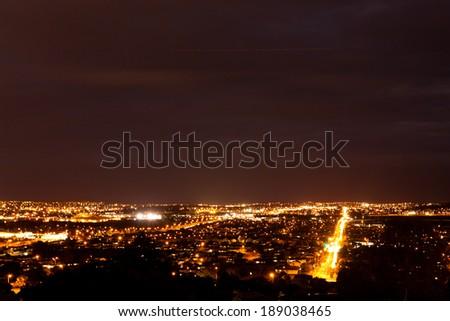 Night over illuminated Manukau, southern suburb of Auckland, New Zealand - stock photo