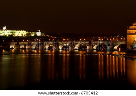 night panorama of ancient bridge in old town