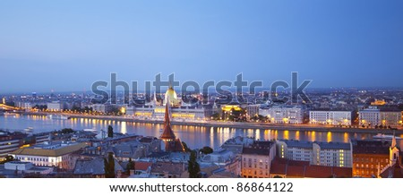 Night panorama of Budapest with Danube and Parliament - stock photo