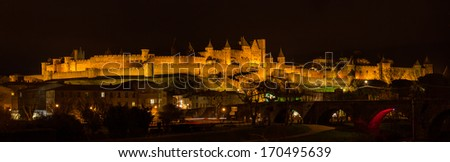 Night panorama of Carcassonne fortress - France, Languedoc-Roussillon - stock photo