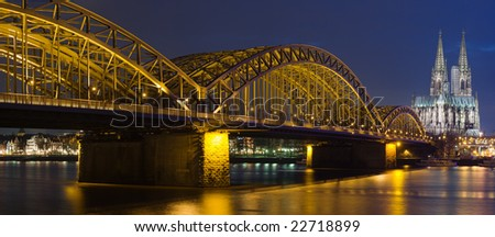 Night panorama of Cologne Cathedral and railway bridge over river Rhine