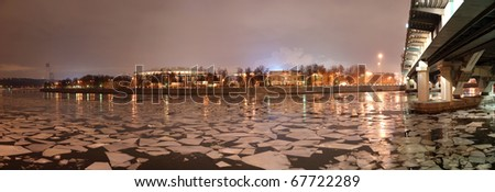 Night panorama of the winter river and a big sports arena of the Olympic Complex Luzhniki, Moscow, Russia - stock photo